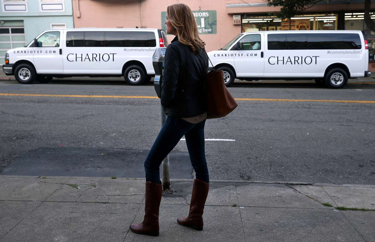 """Jennifer Gronski waits to board an inbound """"Chestnut Bullet"""" Chariot commuter van in the Marina District in San Francisco, Calif. on Tuesday, March 17, 2015."""