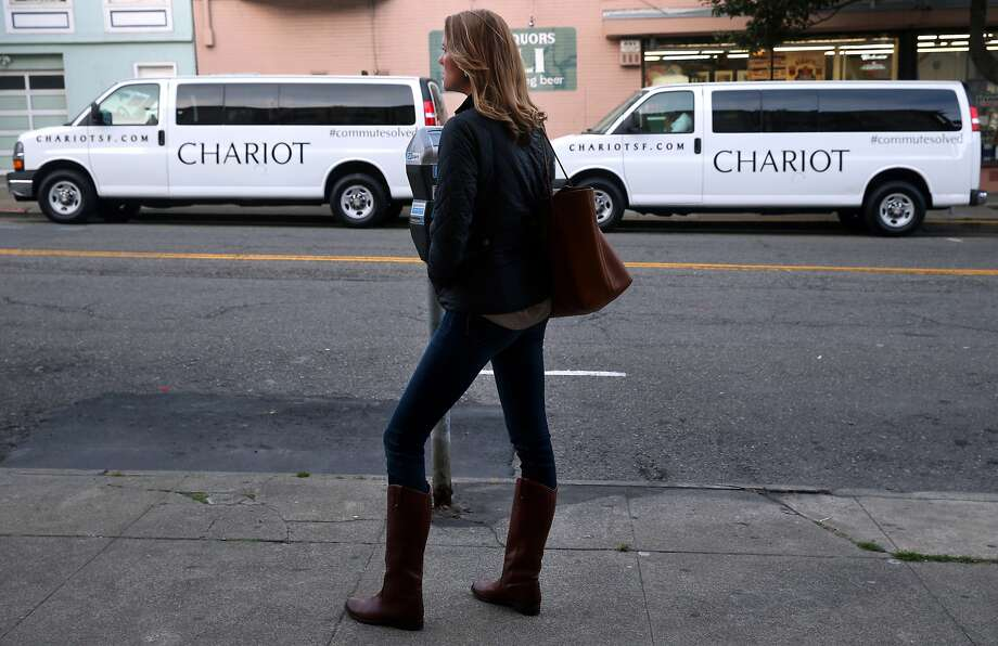 "Jennifer Gronski waits to board an inbound ""Chestnut Bullet"" Chariot commuter van in the Marina District in San Francisco, Calif. on Tuesday, March 17, 2015. Photo: Paul Chinn, The Chronicle"