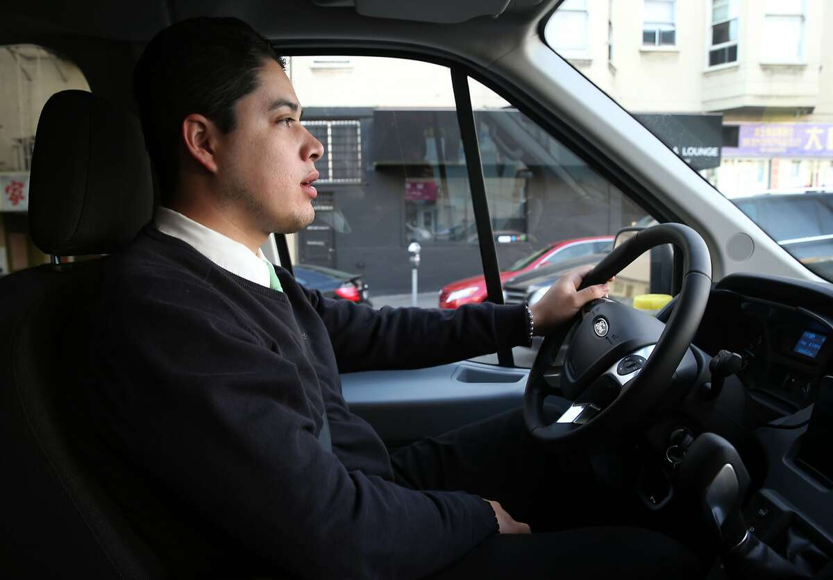 Jaime Pescador, who's been driving for the Chariot commuter van service since January, returns to the Marina District for another run after dropping off passengers in San Francisco, Calif. on Tuesday, March 17, 2015.
