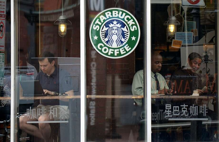 "Led by a $30 million investment from Starbucks CEO Howard Shultz, 17 major companies have committed to providing jobs, internships and apprenticeships to 100,000 ""opportunity youth,"" as they're calling them. Photo: Jewel Samad, AFP / Getty Images"