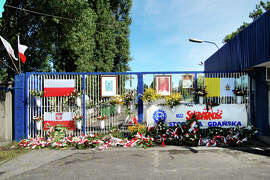 The gate at the Gdansk shipyard, where Polish workers staged their 1980 protest, is treated like a shrine.