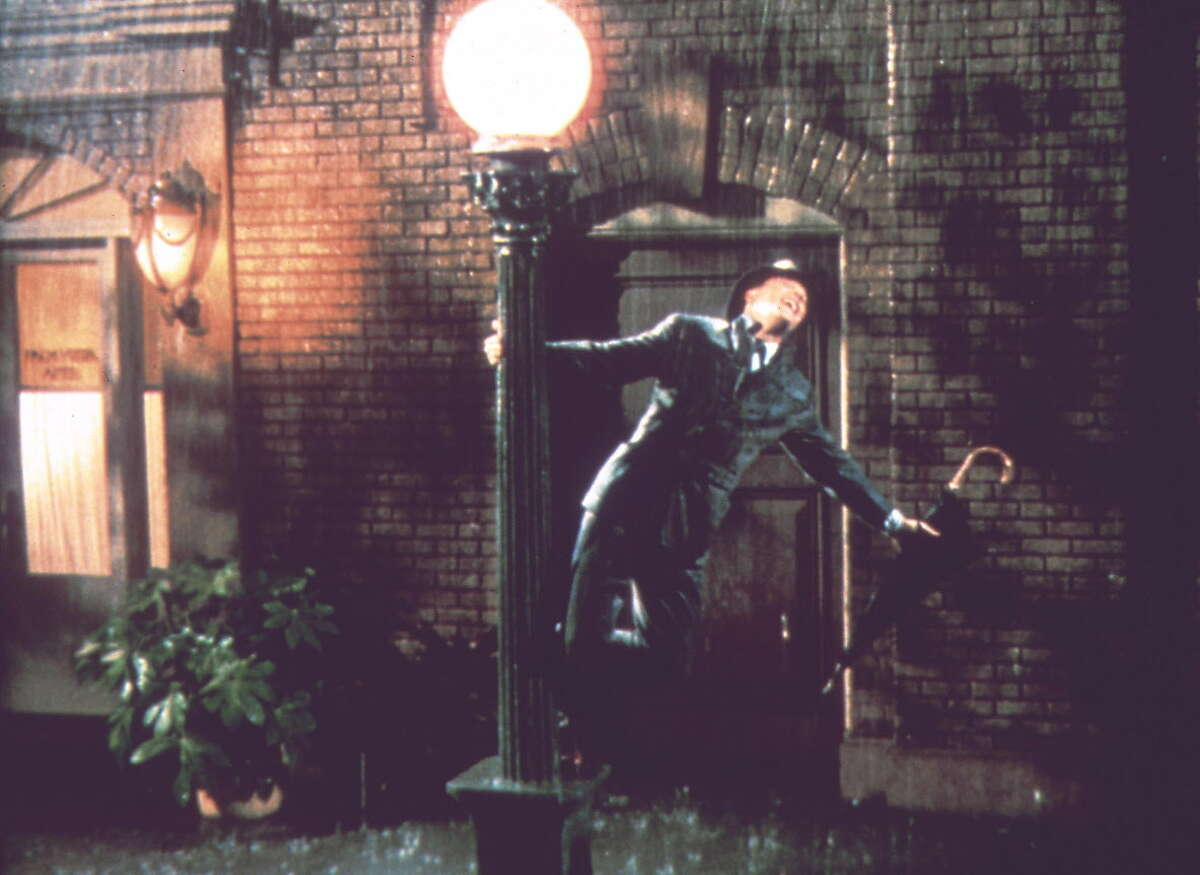 Associated Press Archive Gene Kelly performs the classic, soggy title song in the 1952 movie