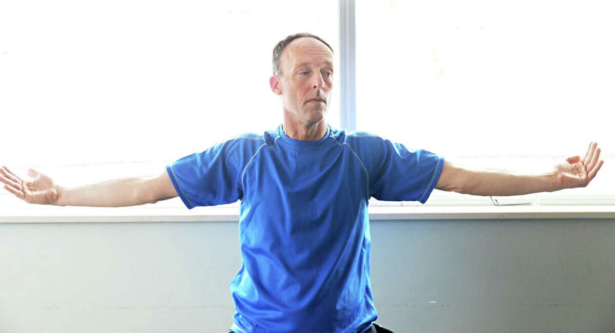 Bruce Plotsky of Clarksville during a Yoga for Parkinson's class at Honest Weight Food Co-op's community room Thursday March 5, 2015 in Albany, NY. (John Carl D'Annibale / Times Union)