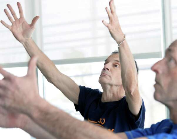 Tom Stephany of Delmar during a Yoga for Parkinson's class at Honest Weight Food Co-op's community room Thursday March 5, 2015 in Albany, NY.  (John Carl D'Annibale / Times Union) Photo: John Carl D'Annibale / 10030886A