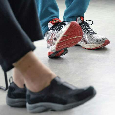 Students do an exercise during a Yoga for Parkinson's class at Honest Weight Food Co-op's community room Thursday March 5, 2015 in Albany, NY.  (John Carl D'Annibale / Times Union) Photo: John Carl D'Annibale / 10030886A