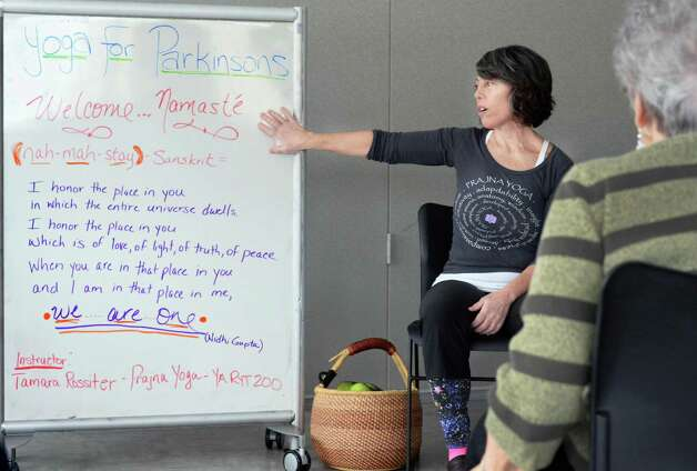 Instructor Tamara Rossiter conducts a Yoga for Parkinson's class with students, from left, Tom Stephany of Delmar, Loretta Brogna of Niskayuna and Bruce Plotsky of Clarksville at Honest Weight Food Co-op's community room Thursday March 5, 2015 in Albany, NY.  (John Carl D'Annibale / Times Union) Photo: John Carl D'Annibale / 10030886A