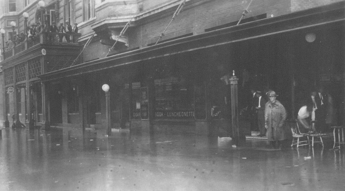 Once the flash flood reached San Antonio, Olmos Creek overflowed its banks and swept into the city. Downtown, water depth ranged from 1- to 12-feet deep. In this photo, the Gunter Hotel is shown inundated by floodwaters.
