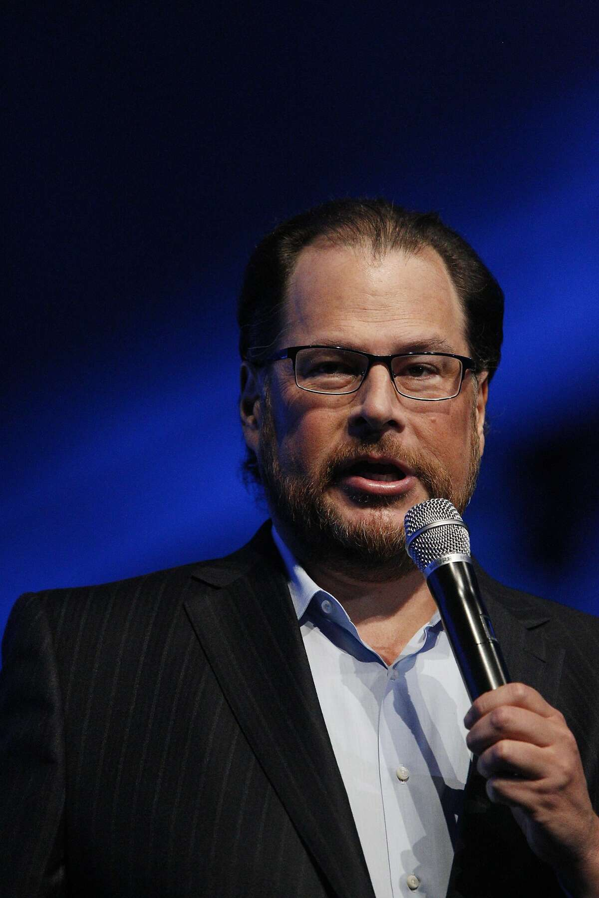 Marc Benioff, Salesforce chairman and CEO, speaks on stage before former Secretary of State Hillary Rodham Clinton gives her keynote in Moscone South on Tuesday, October 14, 2014 in San Francisco, Calif.