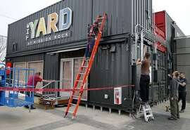 The main facade of the Yard at Mission Bay is made up of several recycled containers Monday March 16, 2015. The Giants' Yard at Mission Rock bills itself as a pop-up shipping container village that has local food and drink, public space and events. It joins other shipping container stores like Proxy at Octavia and Hayes Streets in San Francisco, Calif.