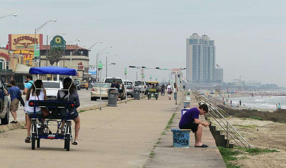 A surrey is pedaled along Seawall Boulevard Monday, March 16, 2015, in Galveston. Photo: James Nielsen, Houston Chronicle / © 2015  Houston Chronicle