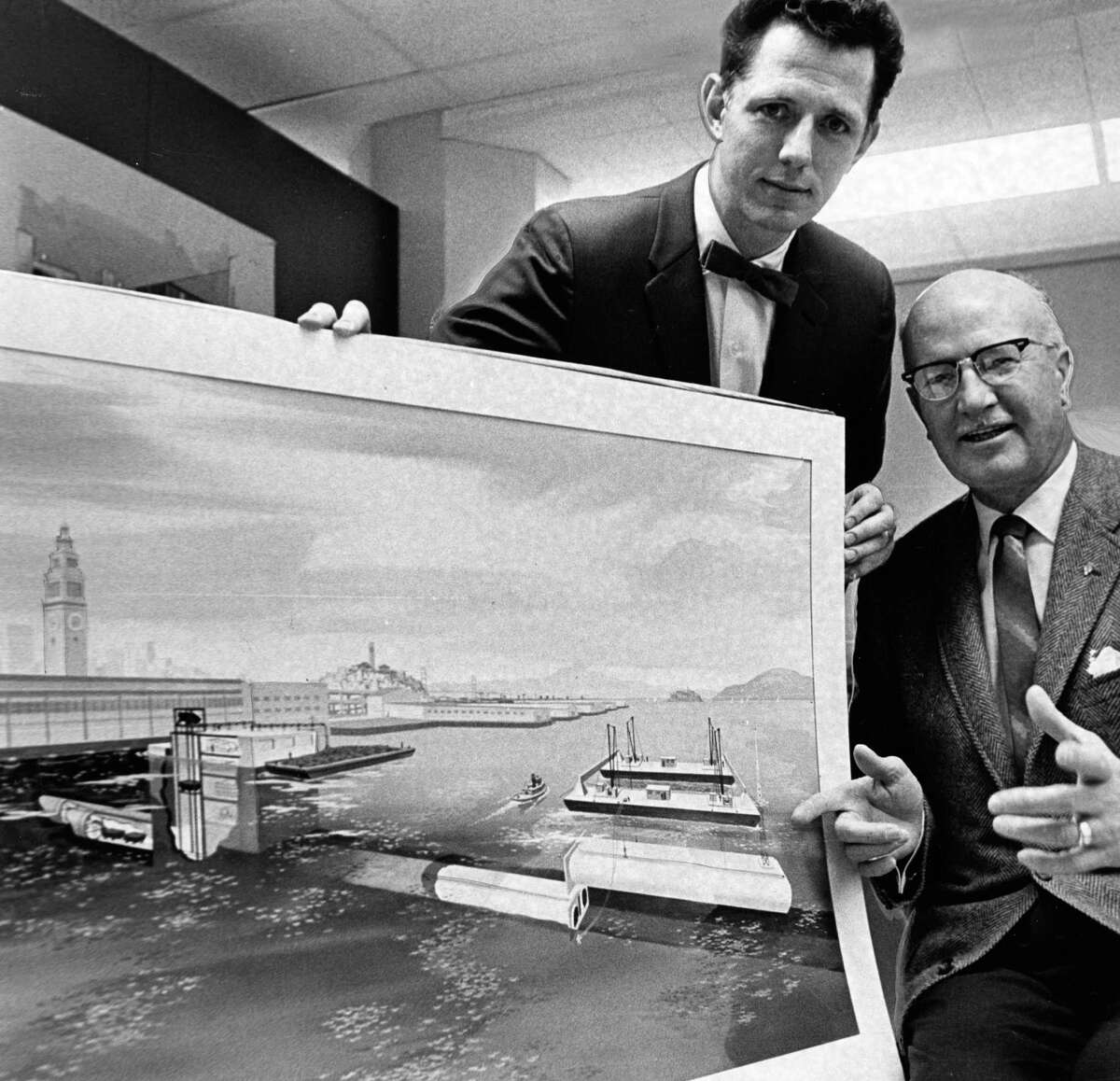 Martin Kelley (left) and C.L. Gallimore, engineers with the Peter Kiewit Co., which built the BART bay tube, show an artist's sketch of the tunnel in 1966.