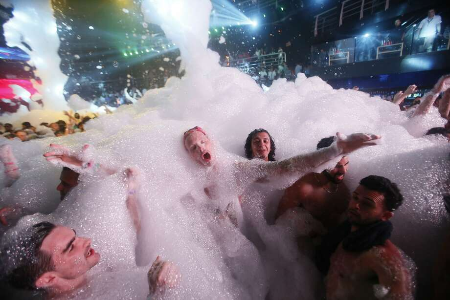 Spring Breakers are covered in foam at The City nightclub in the Caribbean resort city of Cancun, Mexico, early Monday, March 16, 2015.  Photo: Israel Leal, Associated Press
