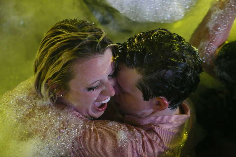 Spring Breakers embrace during a foam bath party at The City nightclub in the Caribbean resort city of Cancun, Mexico, early Monday, March 16, 2015.  Photo: Israel Leal, Associated Press