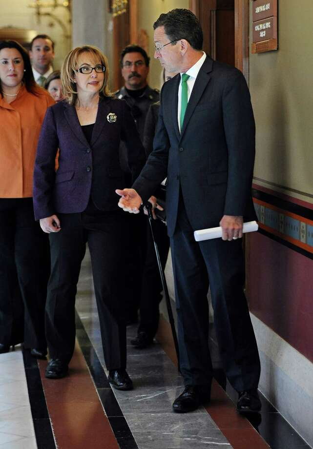 Former Arizona U.S. Rep. Gabby Giffords, left, and Connecticut Gov. Dannel P. Malloy walk to a meeting at the state Capitol, Tuesday, March 17, 2015, in Hartford, Conn.  Giffords was on hand to help promote the latest gun control proposals offered since the Newtown school shootings. Photo: Jessica Hill, AP Photo/Jessica Hill / Associated Press AP Photo/Jessica Hill