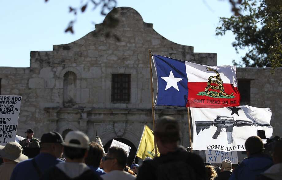 "Take a closer view of how Texas would look if the state actually did split up. In this Oct. 19, 2013 file photo, flags fly at the ""Come And Take It San Antonio"" rally. Photo: Associated Press"