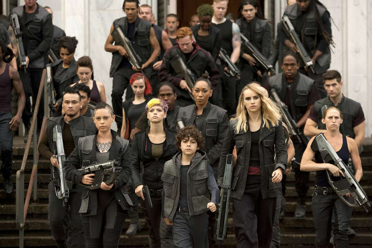 In this image released by Lionsgate, Rosa Salazar, foreground from left, Emjay Anthony and Suki Waterhouse appear in a scene from