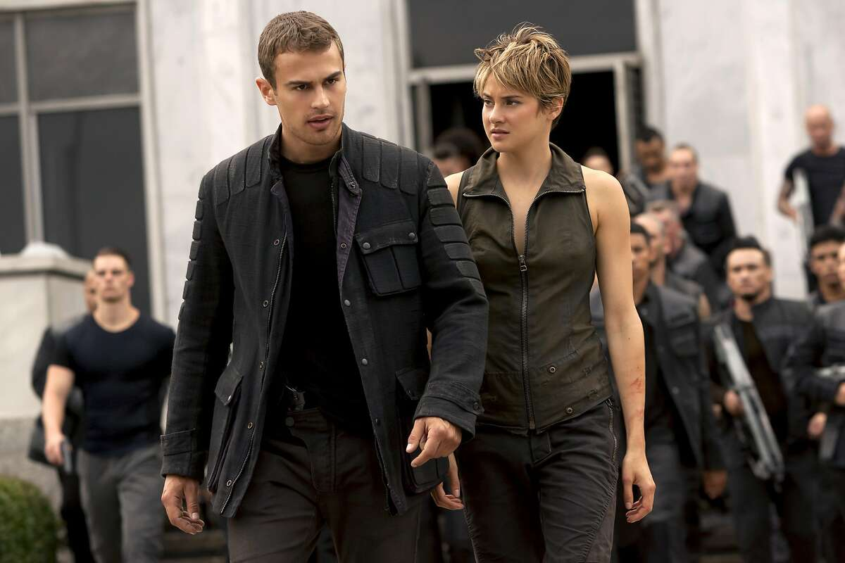 In this image released by Lionsgate, Theo James, left, and Shailene Woodley appear in a scene from