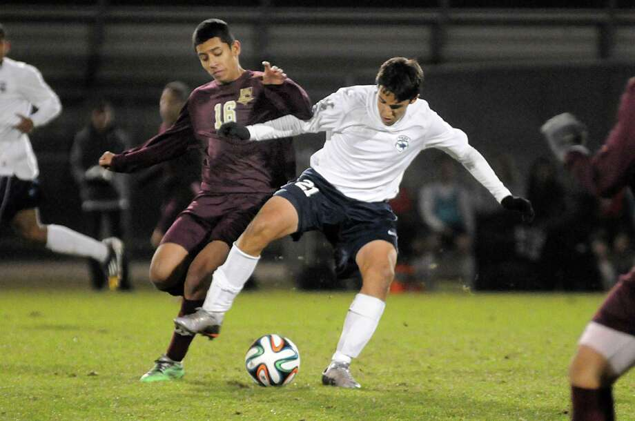 Magnolia West's Jesus Estrada plays defense against Tomball Memorial's Tucker Thompson during the Magnolia West at Tomball Memorial soccer game. Photograph by David Hopper Photo: David Hopper, Freelance / freelance