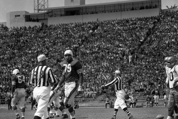 8/25/1957 San Francisco 49ers vs the Redskins, Bob St. Clair (79) talking to the referee , at Kezar Stadium