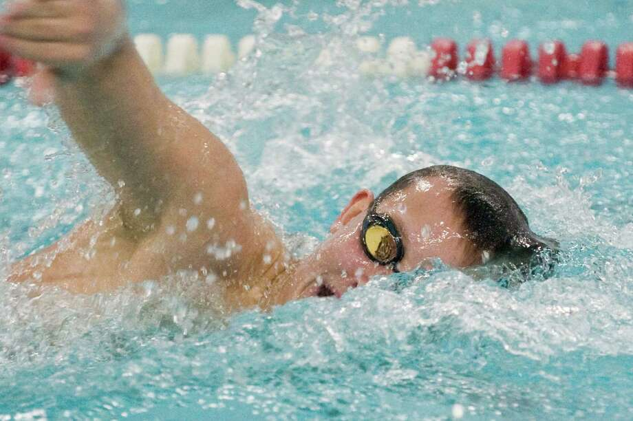 Pomperaug High School's John Feller swims the 200 freestyle during a meet against Brookfield High School held at Pomperaug. Friday, Jan. 16, 2015 Photo: Scott Mullin / The News-Times Freelance