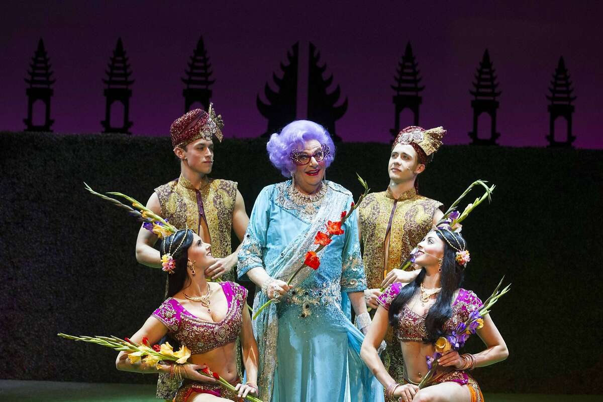 Barry Humphries as Dame Edna Everage and backup dancers