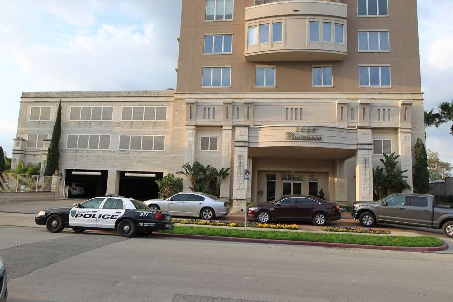 Houston police were seen outside Robert Durst's condo building in Rice Village on Tuesday. Photo: James Nielsen, Chronicle