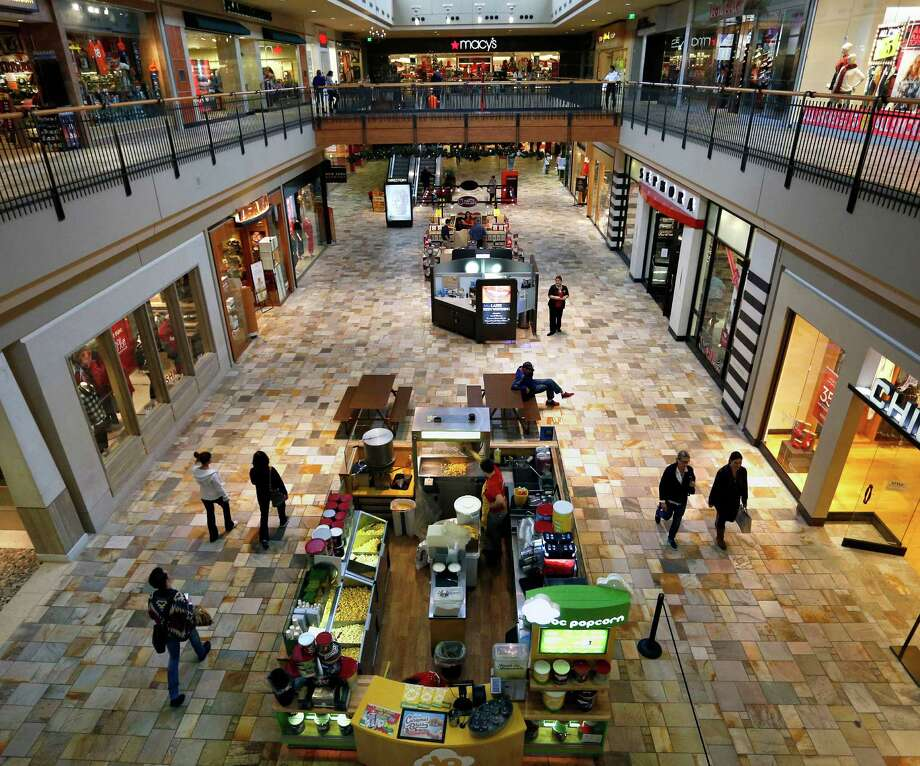 """FILE - In this Nov. 28, 2014 file photo, shoppers look for deals inside the Flatiron Crossing Mall, a Macerich property in Broomfield, Colo. Mall operator Macerich on Tuesday, March 17, 2015 rejected a $16 billion hostile bid from competitor Simon Property Group and adopted a """"poison pill"""" defense to defend against a takeover. (AP Photo/Brennan Linsley, File) ORG XMIT: NYBZ114 Photo: Brennan Linsley / AP"""