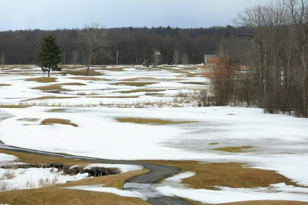 View from the club house shows the golf course expanse out to Union Avenue, where the flag marks the entrance, on Tuesday, March 17, 2015, at Saratoga National Golf Club in Saratoga Springs, N.Y. (Cindy Schultz / Times Union) Photo: Cindy Schultz / 00031064A