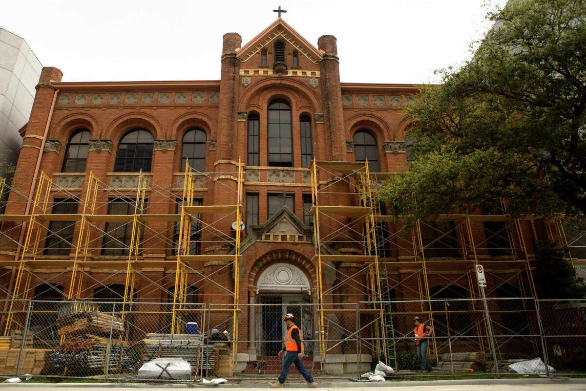 Scaffolding and hardhats surround the Incarnate Word Academy on Tuesday as demolition crews prepare to tear down the 19th century landmark structure.