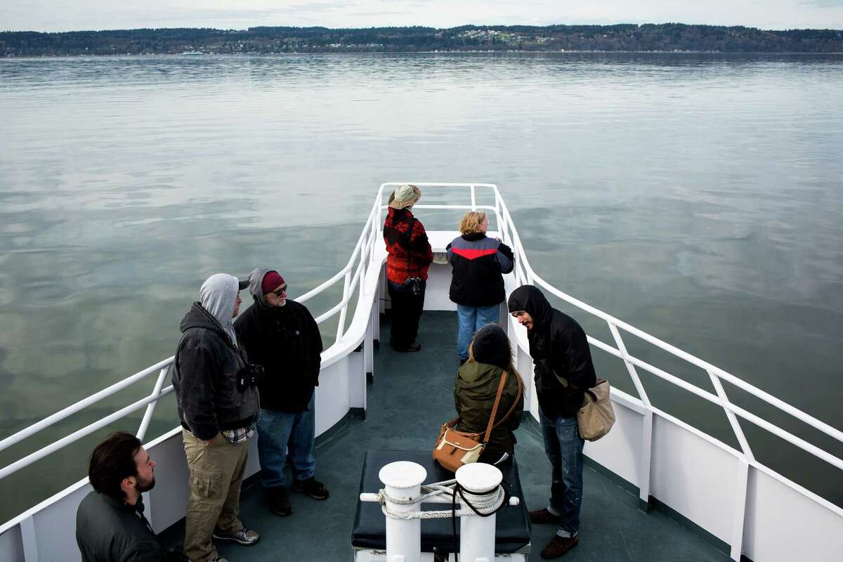 Sightseers enjoy the views as seen on a whalewatching tour provided by Island Adventures on Tuesday, March 17, 2015, near Everett. Every year, migrating gray whales make a journey from the Baja Peninsula to Alaska. The hungry whales stop to feed in the calm protected waters of the Saratoga passage between Camano and Whidbey Islands and leave by the beginning of May.