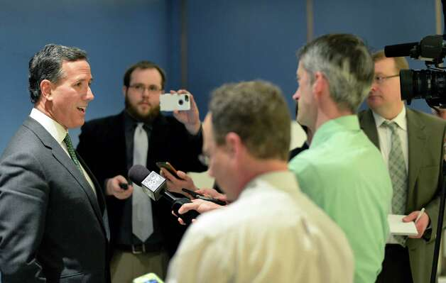 Former presidential candidate Rick Santorum speaks with reporters after addressing the New York Family Research Foundation's lobby day in the Convention Center at the Empire State Plaza Tuesday March 17, 2015 in Albany, NY.  (John Carl D'Annibale / Times Union) Photo: John Carl D'Annibale / 00031052A