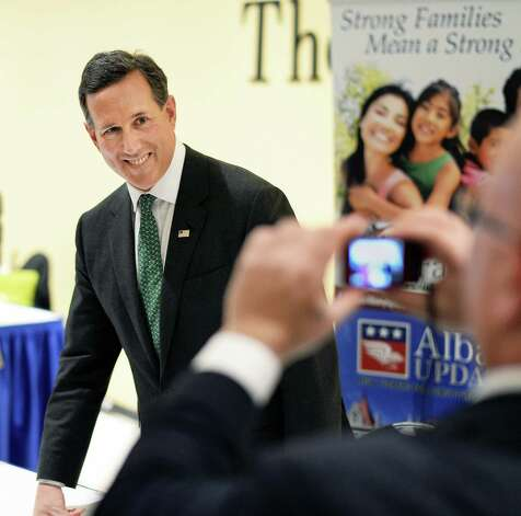 Former presidential candidate Rick Santorum poses for pictures  during the New York Family Research Foundation's lobby day at the Convention Center at the Empire State Plaza Tuesday March 17, 2015 in Albany, NY.  (John Carl D'Annibale / Times Union) Photo: John Carl D'Annibale / 00031052A