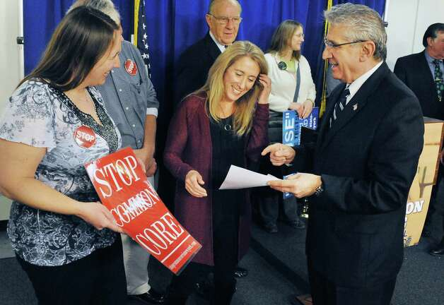 Parents Briana Bays, left, of Clifton Park, and Tricia Farmer of Burnt Hills speak with Assemblyman James Tedisco, right, before a news conference for passage of new Common Core Parental Refusal Act legislation in the LOB Tuesday March 17, 2015 in Albany, NY.  (John Carl D'Annibale / Times Union) Photo: John Carl D'Annibale / 00031060A