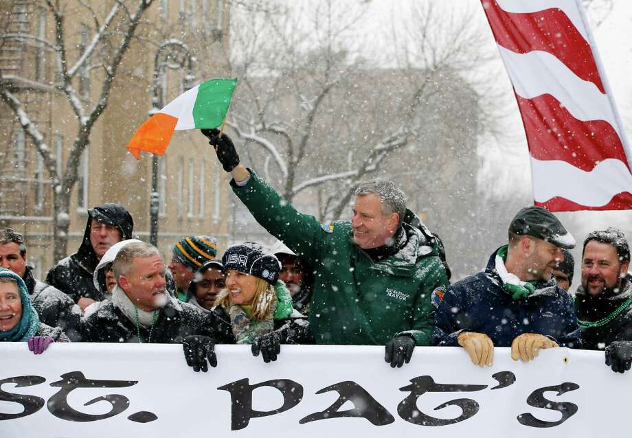 FILE - In this March 1, 2015 file photo, New York Mayor Bill de Blasio, waves the flag of Ireland as he marches beside Kerry Kennedy, third from left, during the all-inclusive St. Pat's For All parade in the Sunnyside, Queens neighborhood of New York. The parade, which embraces diversity and inclusion, is considered an alternative to the New York City's official St. Patrick's Day parade on March 17. (AP Photo/Kathy Willens, File) ORG XMIT: NYKW201 Photo: Kathy Willens / AP