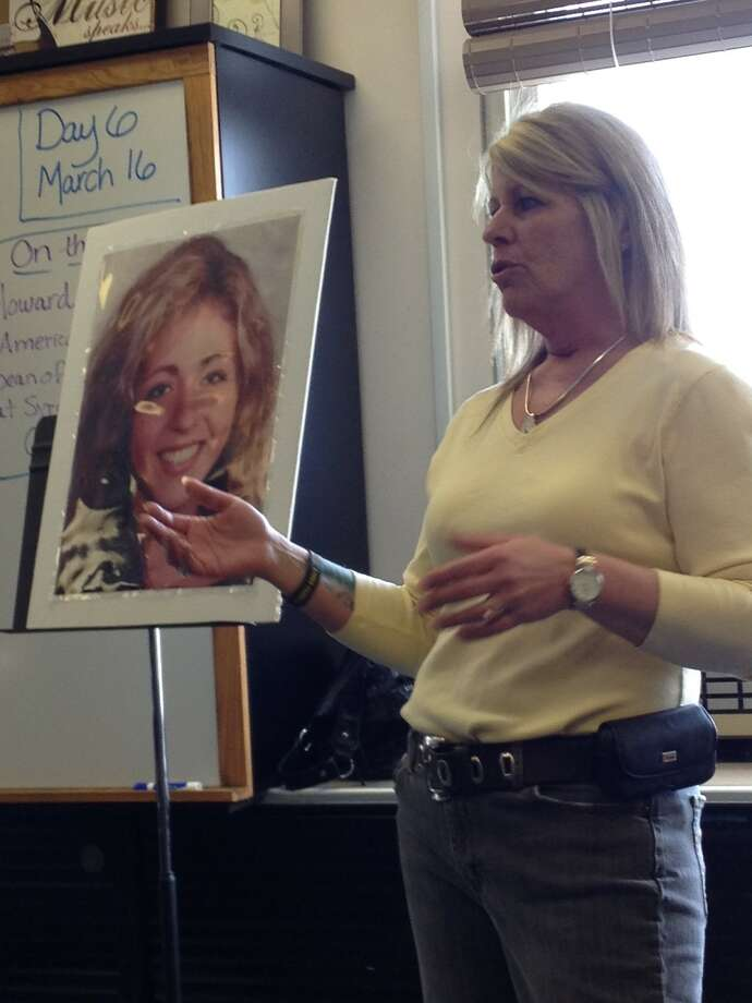 Patty Farrell stands before a large photo of her daughter, Laree, while she speaks to Colonie HS students about how Laree died of a fatal heroin overdose at 18. Her daughter was a 2011 graduate of Colonie HS and Farrell's raw, harrowing talk was meant to alert students to the dangers of heroin and to urge them to seek help for friends experimenting with drugs. (Paul Grondahl / Times Union)