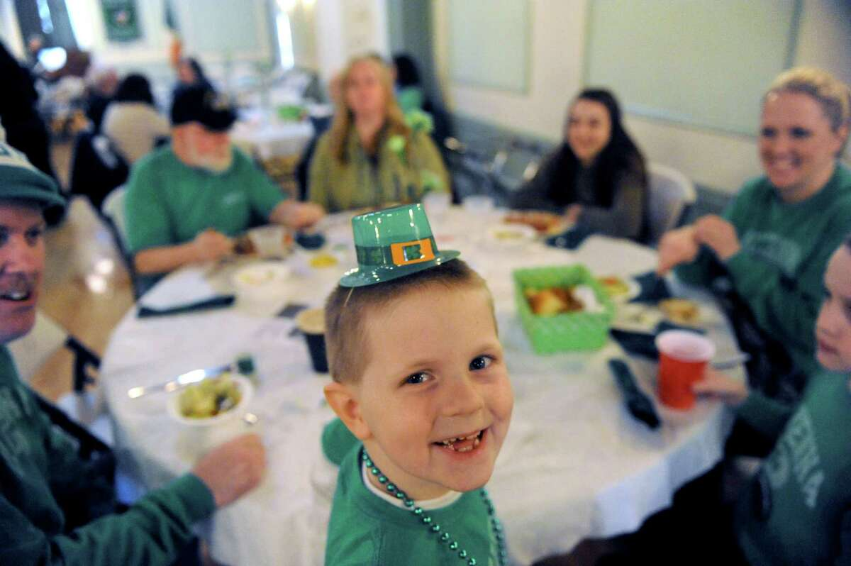 Five-year-old Ryan Patrick McKenna of East Greenbush has St. Patrick's Day corned beef and cabbage at the Capital District Irish American Association with his family on Tuesday March 17, 2015 in Albany, N.Y. (Michael P. Farrell/Times Union)