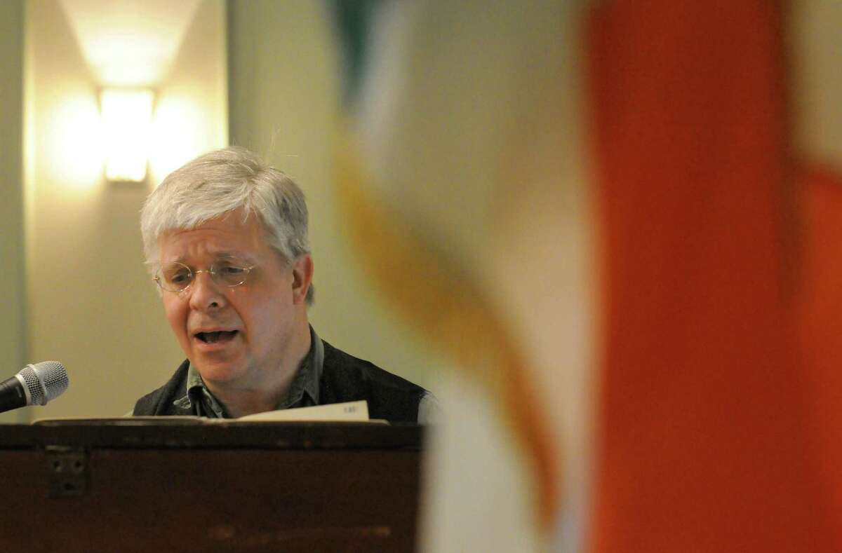 Wally Stock of Brainard sings Irish music during the St. Patrick's Day corned beef and cabbage dinner at the Capital District Irish American Association on Tuesday March 17, 2015 in Albany, N.Y. (Michael P. Farrell/Times Union)