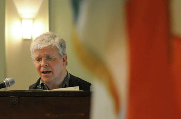 Wally Stock of Brainard sings Irish music during the St. Patrick's Day corned beef and cabbage dinner at the Capital District Irish American Association on Tuesday March 17, 2015 in Albany, N.Y.  (Michael P. Farrell/Times Union) Photo: Michael P. Farrell / 00031054A