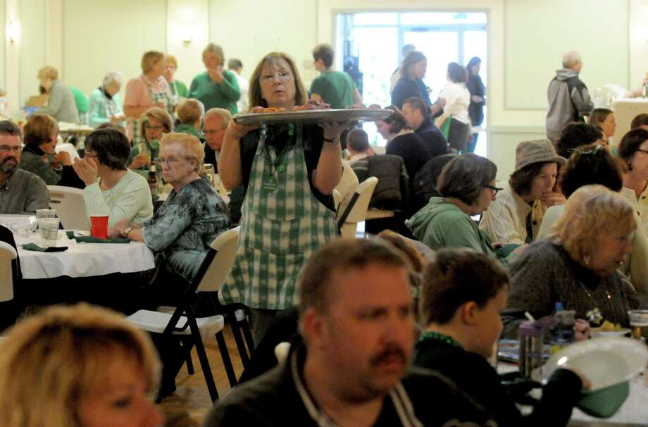 A packed house during the St. Patrick's Day corned beef and cabbage dinner at the Capital District Irish American Association on Tuesday March 17, 2015 in Albany, N.Y.  (Michael P. Farrell/Times Union) Photo: Michael P. Farrell / 00031054A
