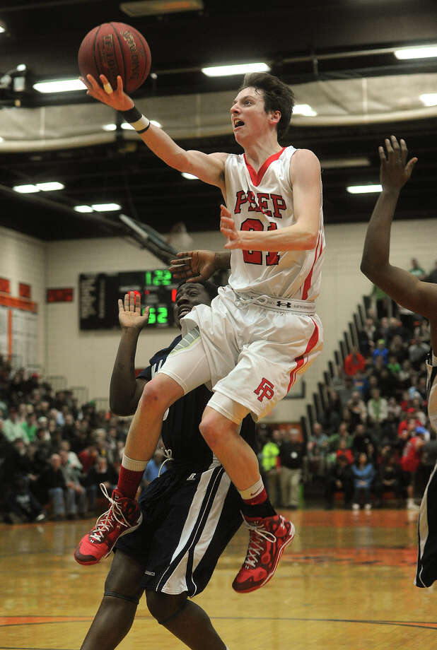 Fairfield Prep's Ryan Foley drives to the basket during the Jesuits' Class LL semifinal game with Hillhouse in the boys basketball state tournament at Shelton High School in Shelton, Conn. on Tuesday, March 17, 2015. Photo: Brian A. Pounds / Connecticut Post
