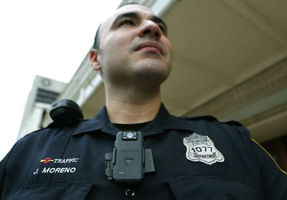 San Antonio Police Officer Johnny Moreno wears a body cam that Chief William McManus spoke to members of city counsel about to be used by certain police officers, if the cameras are approved.  Wednesday, Dec. 10, 2014. Photo: BOB OWEN, Staff / San Antonio Express-News / © 2014 San Antonio Express-News