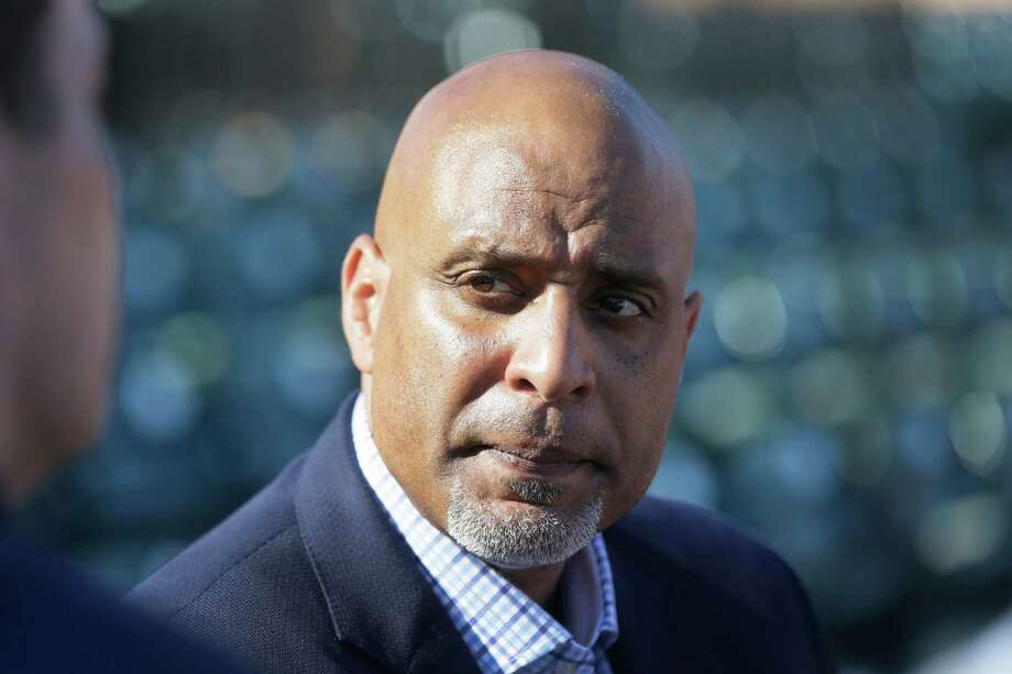 Major League Baseball Players Association executive and former Detroit Tigers first baseman Tony Clark talks to the media before a spring training exhibition baseball game between the Detroit Tigers and the Washington Nationals in Lakeland, Fla., Tuesday, March 17, 2015. (AP Photo/Carlos Osorio) Photo: Carlos Osorio, STF / AP