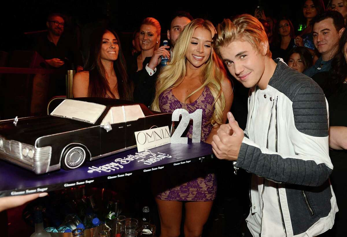 Justin Bieber poses with a birthday cake as he celebrates his 21st birthday at OMNIA Nightclub, Las Vegas in Caesars Palace on March 14, 2015 in Las Vegas, Nevada.