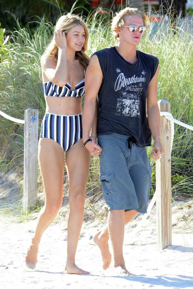 Gigi Hadid and Cody Simpson are seen on the beach on March 15, 2015 in Miami, Florida. Photo: Dave Lee, GC Images / 2015 Dave Lee