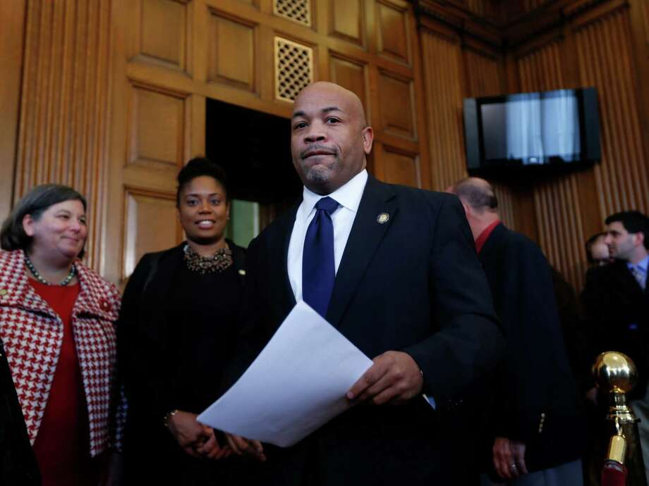Assembly Speaker Carl Heastie, D-Bronx, arrives to a news conference at the Capitol on Tuesday, March 10, 2015, in Albany, N.Y. Assembly Democrats have proposed a $150.7 billion state budget they say will put families first, proposing larger increases in the minimum wage and public school aid than Gov. Andrew Cuomo did, plus increased support for child care, affordable housing and social services. (AP Photo/Mike Groll)  ORG XMIT: NYMG103 Photo: Mike Groll / AP