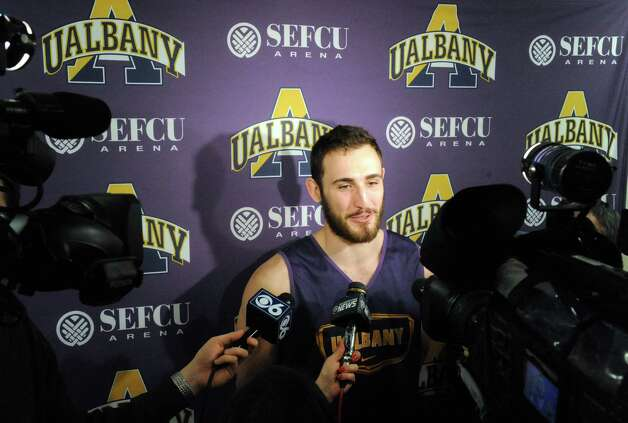UAlbany's Sam Rowley talks with the media prior to basketball practice at the SEFCU Arena on Tuesday March 17, 2015 in Albany, N.Y.  (Michael P. Farrell/Times Union) Photo: Michael P. Farrell / 00031069A