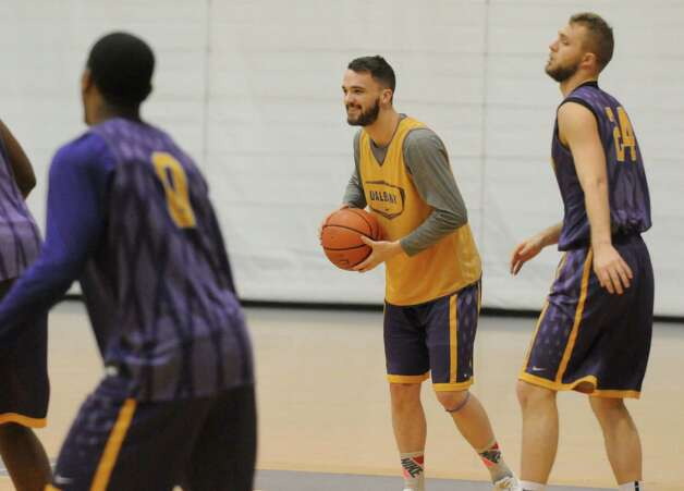 UAlbany's Peter Hooley, center, looks to a pass during basketball practice at the SEFCU Arena on Tuesday March 17, 2015 in Albany, N.Y.  (Michael P. Farrell/Times Union) Photo: Michael P. Farrell / 00031069A