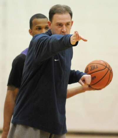 UAlbany head coach Will Brown puts his team through practice at the SEFCU Arena on Tuesday March 17, 2015 in Albany, N.Y.  (Michael P. Farrell/Times Union) Photo: Michael P. Farrell / 00031069A