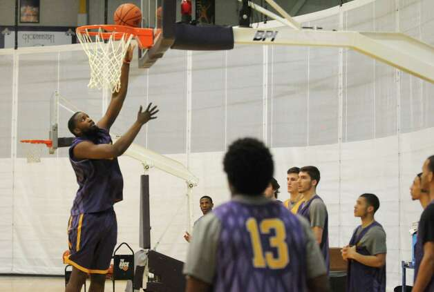 UAlbany's Richar Peters puts in a basket during basketball practice at the SEFCU Arena on Tuesday March 17, 2015 in Albany, N.Y.  (Michael P. Farrell/Times Union) Photo: Michael P. Farrell / 00031069A