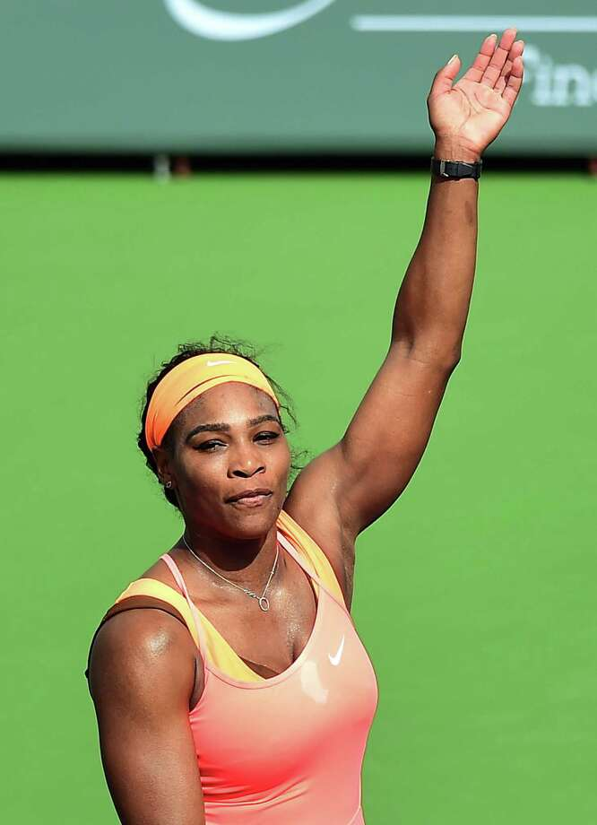 Serena Williams of the US acknowledges the crowd after defeating compatriot Sloane Stephens in their 4th round match at the BNP Paribas Tennis Open in Indian Wells, California on March 17, 2015. Williams defeated Stephens 6-7, 6-2, 6-2. AFP PHOTO/ FREDERIC J. BROWNFREDERIC J. BROWN/AFP/Getty Images ORG XMIT: 538629451 Photo: FREDERIC J. BROWN / AFP